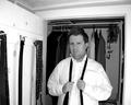 Arbus: Man preparing for funeral, N. J., 2006