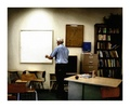 Teacher Taking Down The Last Bulletin