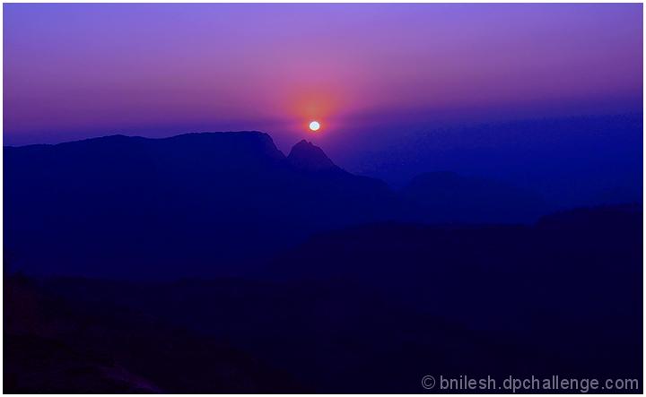 Sun behind the ridges..