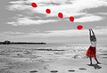 The Girl With The Red Balloons