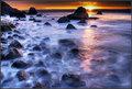Sunset fantasia of a rocky beach