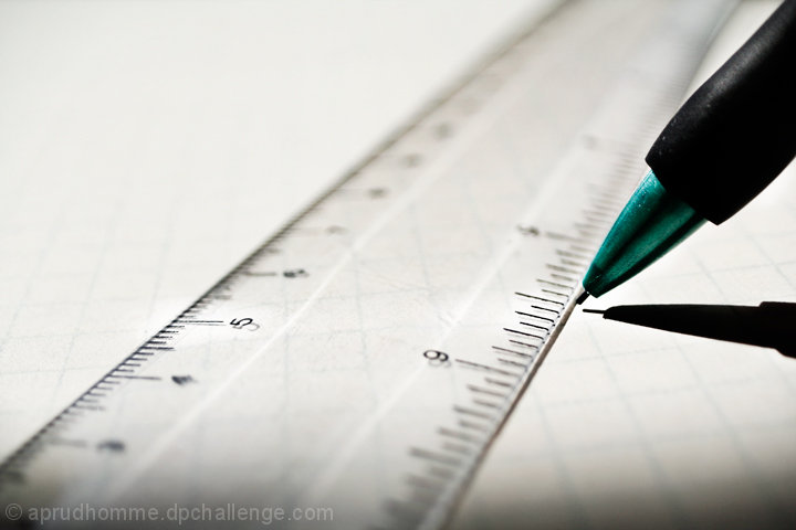 mechanical pencil and clear ruler