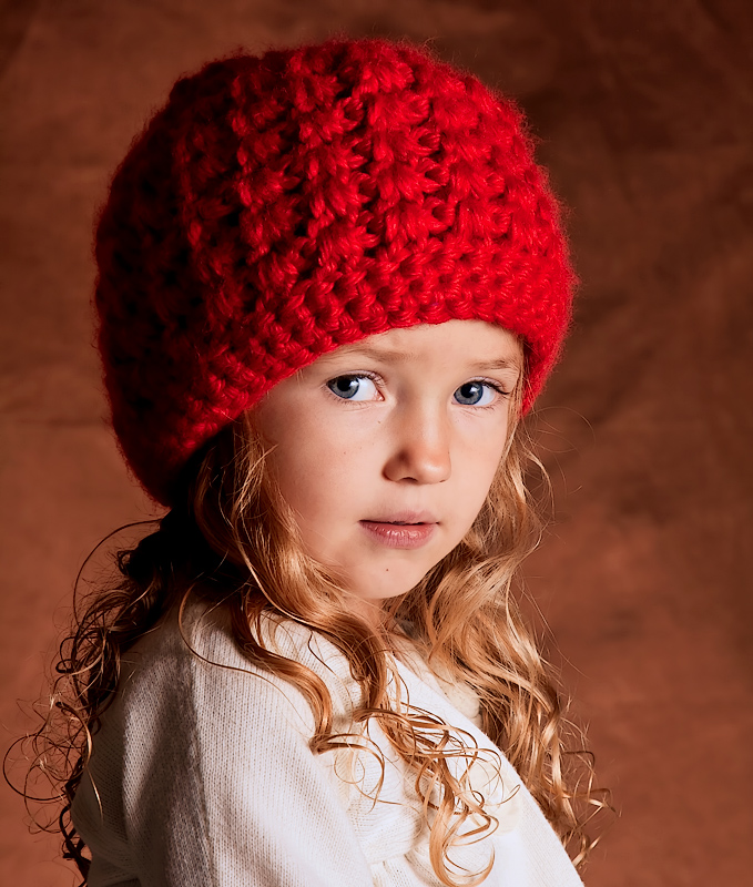 Toddler with the Red Hat and Blue Eyes.