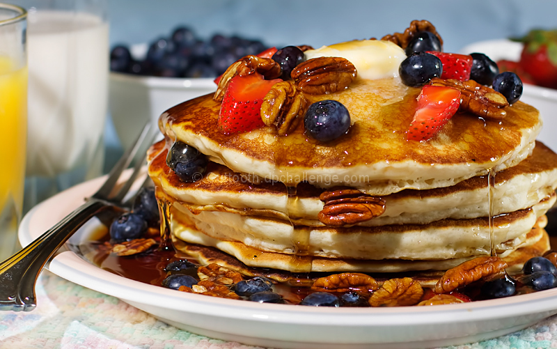 Buttermilk Pancakes With Fresh Berries And Glazed Pecans