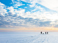 Searching for fish on frozen lake, ice fishing