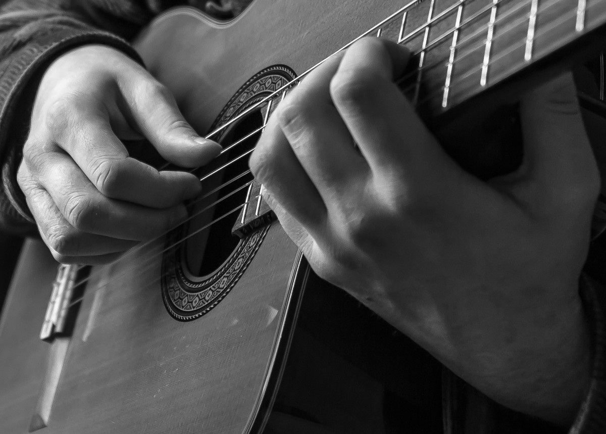 Hands playing Classical guitar