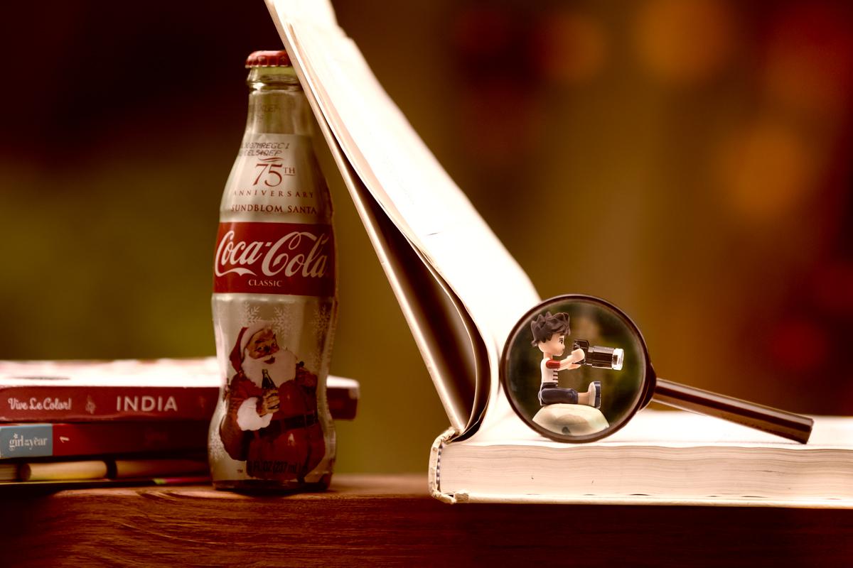 photographer? A traveler? An ad of Coca-Cola? A detective?
