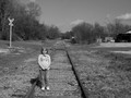 Kylei on train tracks.