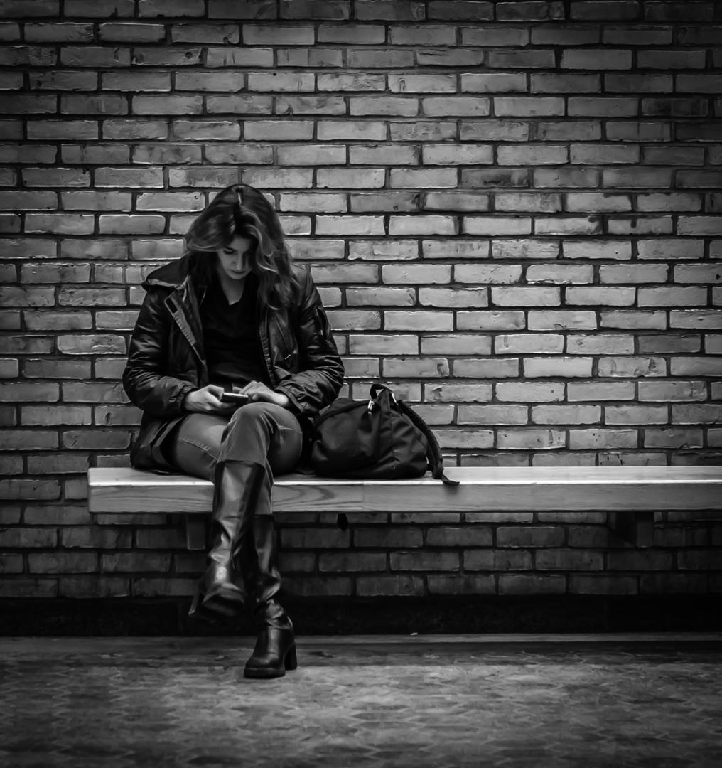 Woman Texting Waiting Subway Train