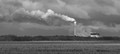 Power Station Smoke Stack Erupts in the Clouds