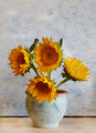 Four Sunflowers In a Vase