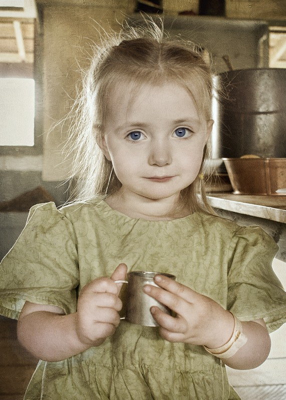 CHILD WITH CUP