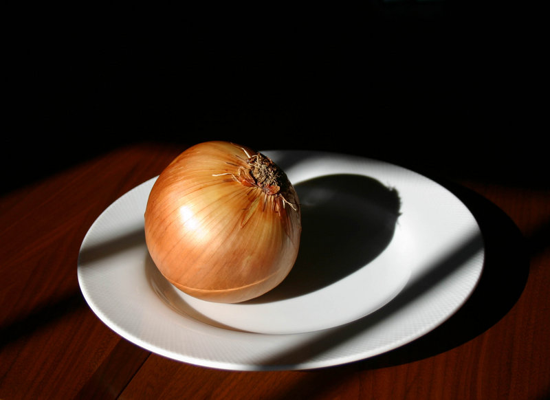 Onion on White Plate