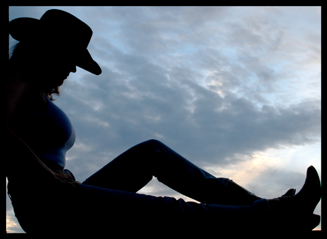 Cowgirl at Sunset
