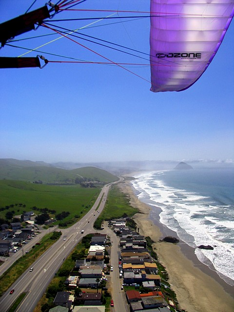 """Hwoo-ya!!""  Cutting thru the Ozone!     (paragliding wing-overs above the beach homes)"