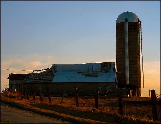 Abandoned Barn and Silo at Sunset