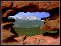 Pikes Peak framed by a natural window  - (using Wikipedia's def. of window - check it out)