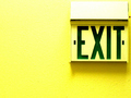 Exit Sign on Yellow Background