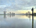 """Monday Morning Blues"" Bleak wintry sunrise over the river Maas in Holland"