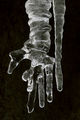 Frozen hand in an icicle