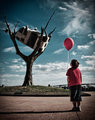 A Boy, A Balloon, and a Cow in a Tree