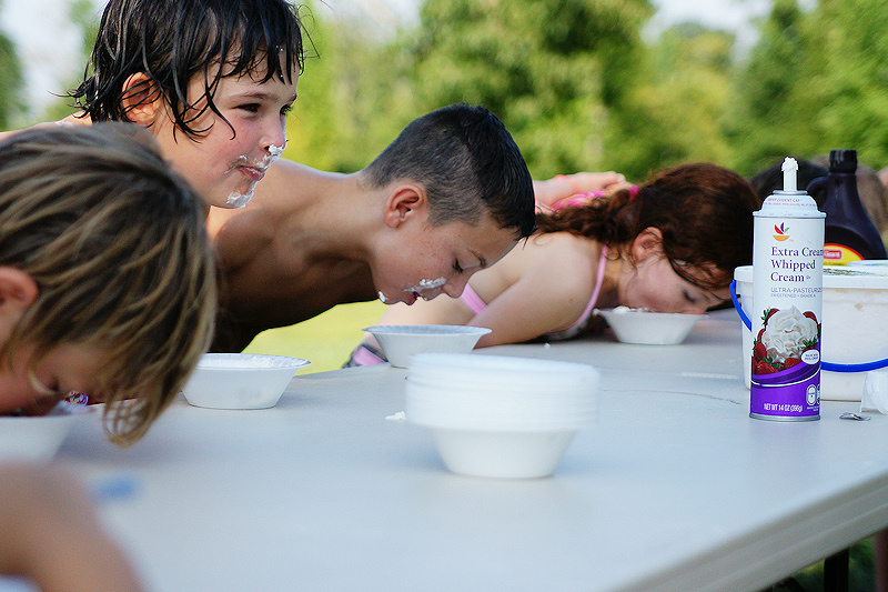 Ice cream eating contest is a 'beat the heat' treat for local kids.