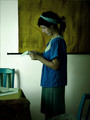 girl in blue reading a letter